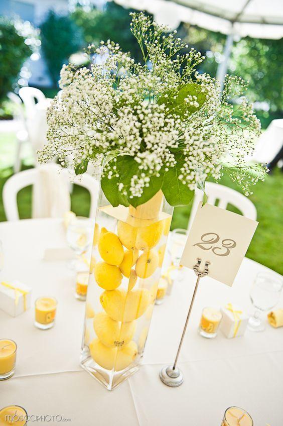 lemons submerged in water in tall vases as wedding CenterPieces / http://www.deerpearlflowers.com/fruit-wedding-ideas/
