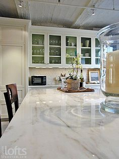 Veined white granite the look of marble and the for Granite durability