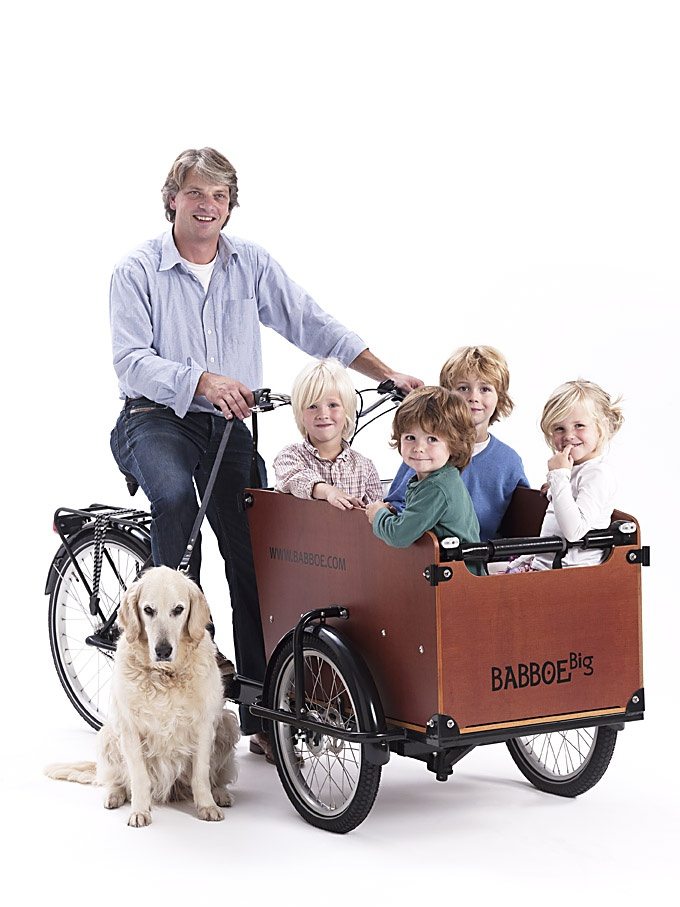 Babboe Big cargo bike This trusted 3-wheel cargo bike is stable and sturdy and can easily transport four children. The Babboe Big is fitted as standard with many extras such as conveniences and safety components. Why a 3-wheel cargo bike? - Children seated safely in the container, secured in safety belts -Very stable; easy to mount and dismount - Remain seated at traffic lights; squeezing your brake is sufficient - Children sit opposite one another making a ride in the carrier fun