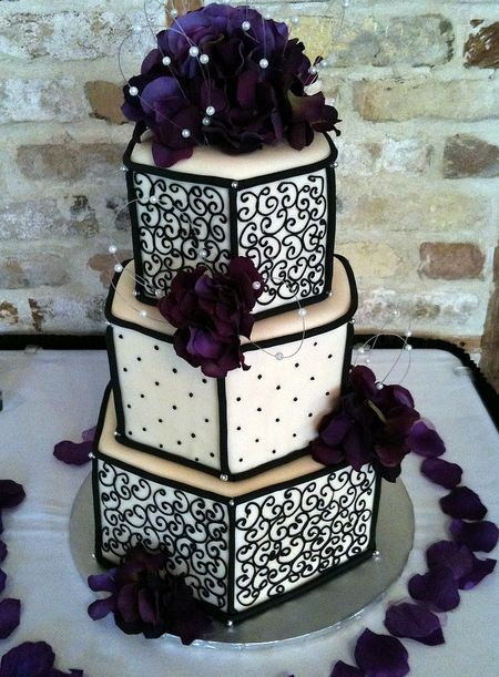 unique black and white wedding cake with different shades of purple flowers.  #weddingideas