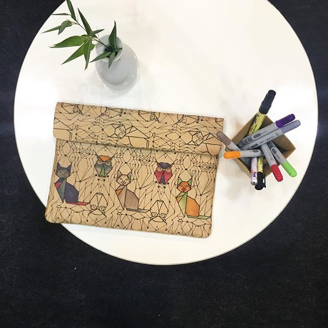 WREN Hand coloured Owl and the Pussycat iPad / Tablet Sleeve at our Giftex2017 Stand in Japan • Screenprint design by Wendren Setzer • Made from recycled cement paper • Stylish • Contemporary • Handmade in Cape Town, South Africa