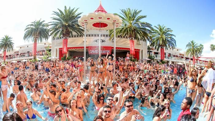 Not your backyard pool party, hundreds cram into the pool at Encore Beach Club as top-name DJs spin