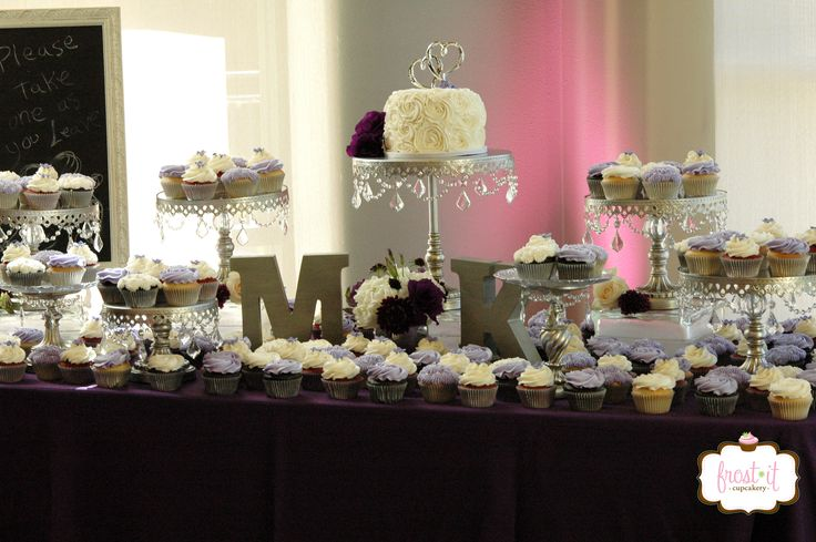 Purple and lavender wedding cupcake table