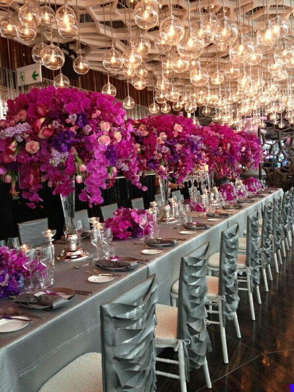 Silver table linens and chair sleeves (wildflower linen Parisian Platinum Chair sleeves and Bunya Silver table Linen) with radiant violet orchids. Florals by Karen Tran Florals