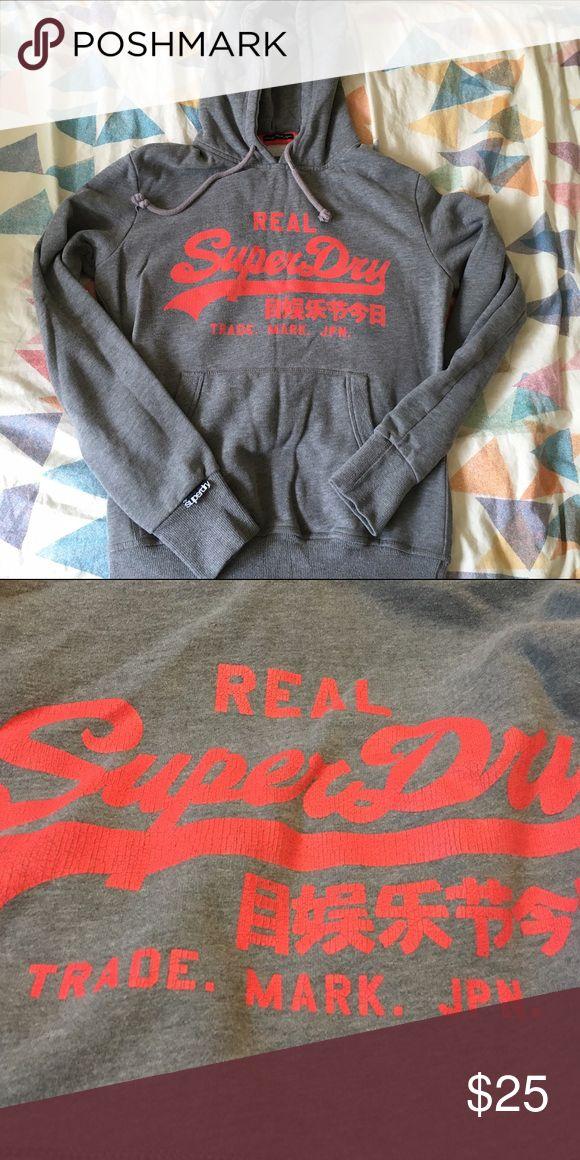 Grey Superdry hoodie Comfy grey superdry hoodie sweatshirt with pink print. Worn a handful of times. Superdry Tops Sweatshirts & Hoodies