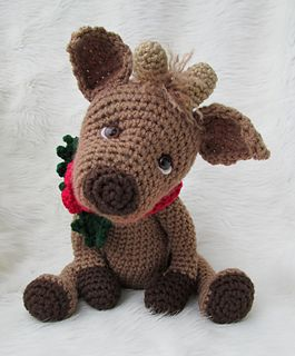 This sweet reindeer uses worsted weight yarn, basic crochet stitches and a size G hook. You'll have him finished in no time, you will need to know how to crochet in the round to finish your reindeer. Pattern includes detailed instructions (in English), a materials list and helpful notes and tips to help create your reindeer. Finished reindeer will be approx. 13 inches tall from top of head to bottom of feet, not counting his ears, approx. 9 inches tall sitting from top of head to bottom.