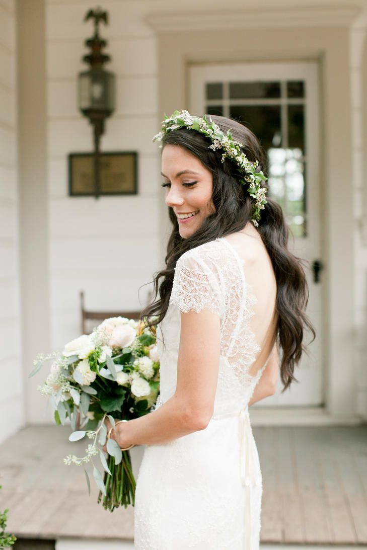This Sarah Seven bridal gown features a delicate lace-cap sleeves and back, which tapers into an exposed back.