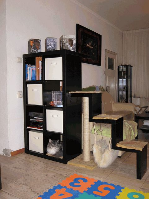 Diy cat stairs ikea hack lack shelves caturday for Bookshelf cat tower