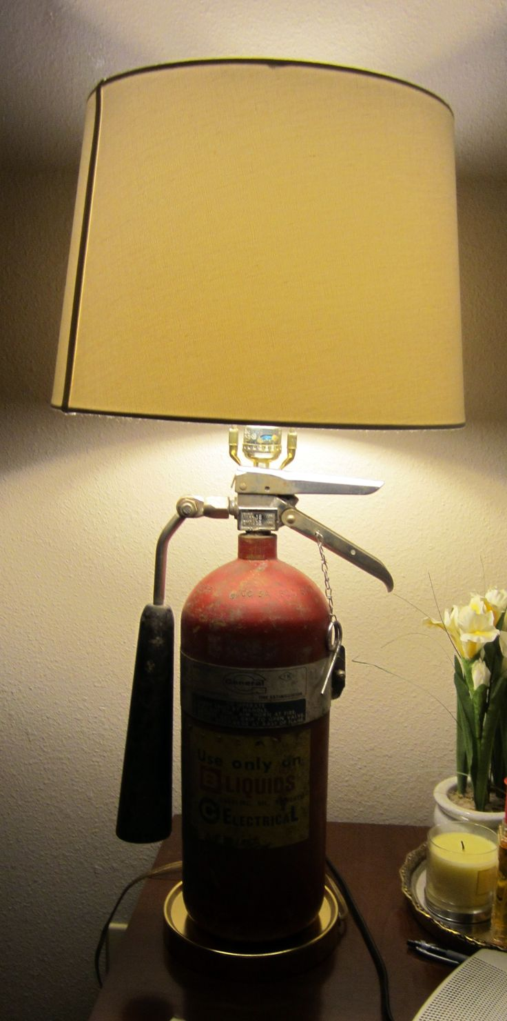 Recycle an empty fire extinguisher by turning it into a lamp. Took the guts of an old, ugly thrift store lamp to bring life to this one.