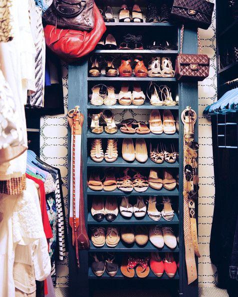 Organization - Shoe organization on blue shelves in a walk-in closet