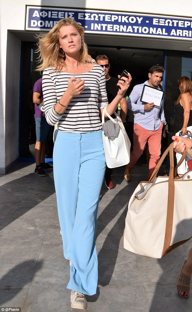 Toni Garrn defines travelling in style as she puts on a leggy display #dailymail