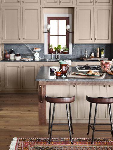 kitchen's soapstone counters, backsplash, and mahogany stools