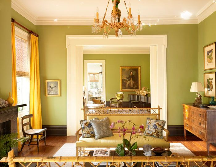 Greek Revival Decoration The front parlor is centered upon a pair of gilt-wood Regency benches. The handsome shade of green on the walls continues into the back parlor where it is also balanced with yellow silk curtains.