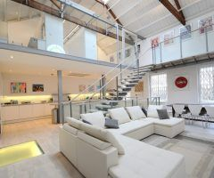 exposed rafters living room industrial with preaked roof wooden sectional sofas
