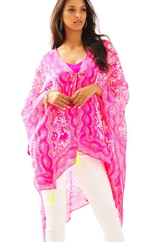 Please welcome your newest favorite beach cover up: The Island Caftan - Tons Of Fun. The printed kimono scarf looks great over your bathing suit, has tassels and a self-tie closure. What more could you ask for?