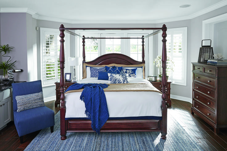 Ashley's Lavidor canopy bed all dressed in blue. Add a pop