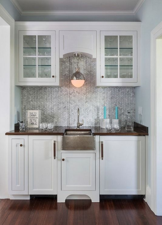 wood countertop glass front cabinets