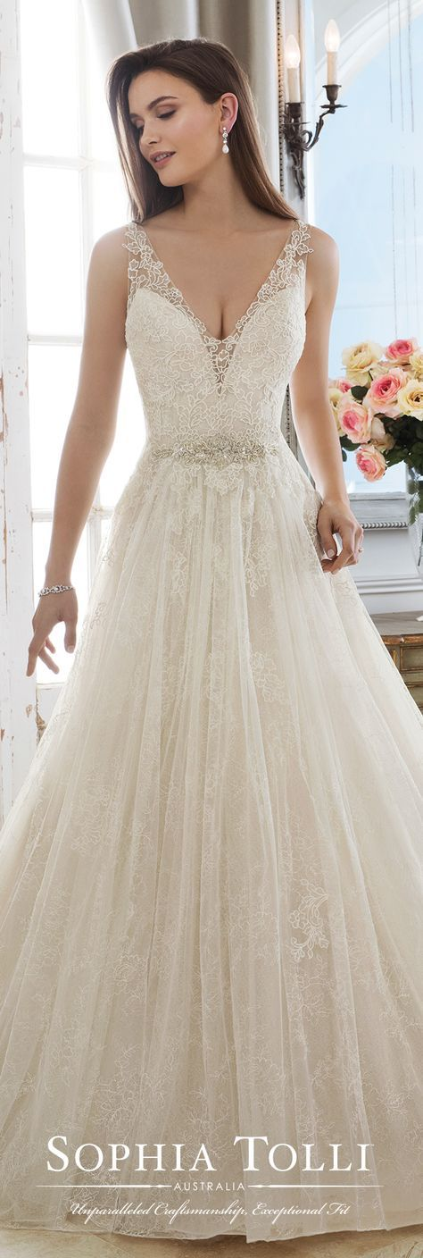 Ballgown Wedding Dress by Sophia Tolli for Mon Cheri Bridals - a sleeveless soft lace over tulle A-line gown featuring illusion lace straps and a plunging V-neck with an illusion modesty panel, a hand-beaded crystal and pearl natural waist motif, an illusion lace V-back trimmed with diamante buttons, a full gathered skirt and a chapel train. #weddingdresses #weddinggowns #bridaldress #bride #bridal #bridalgown #brides #weddings