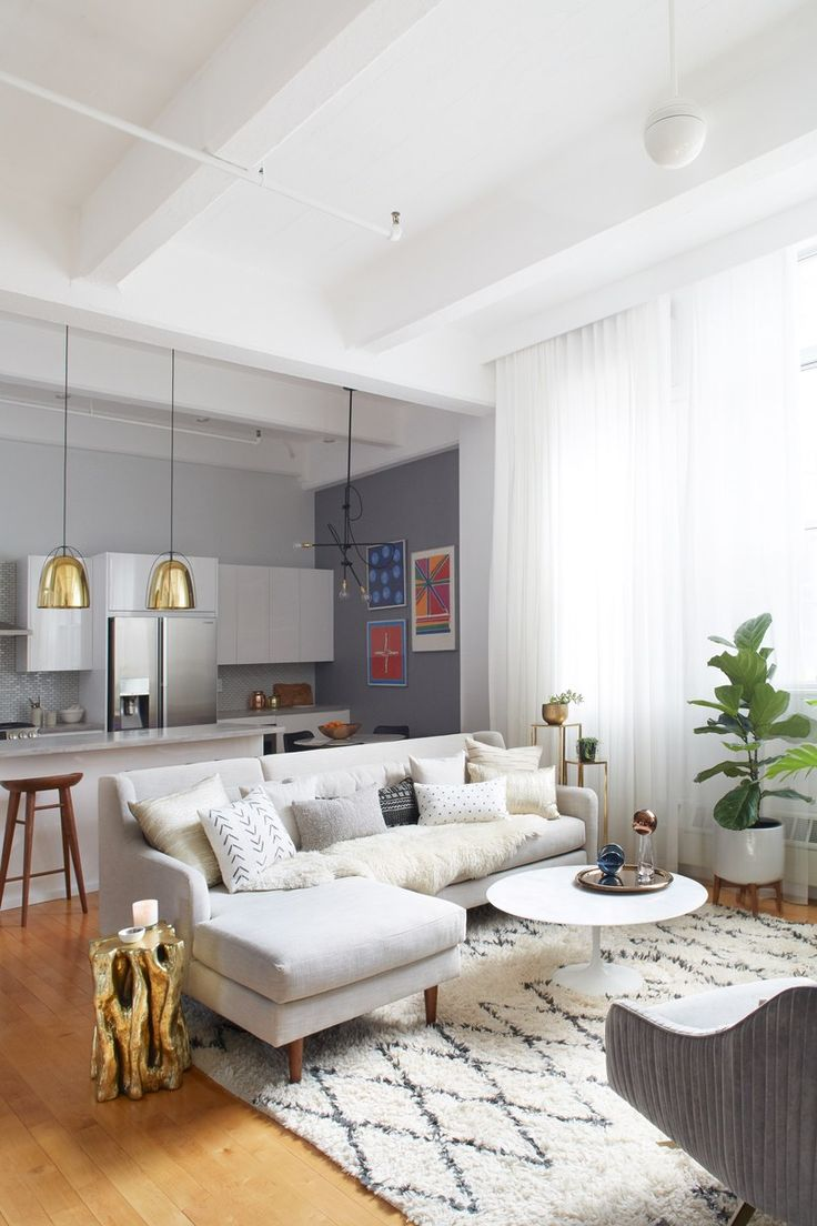 Antonina Jedrzejczak Floor-to-ceiling curtains draw attention to the 12-foot ceilings in the living room of this Brooklyn apartment | archdigest.com