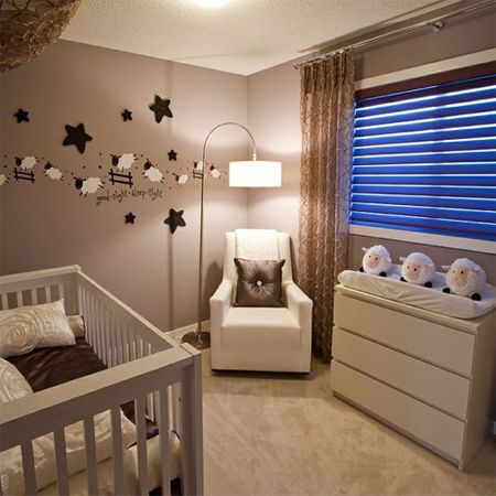 Decorate a gender-neutral nursery with a lamb or sheep theme brown beige