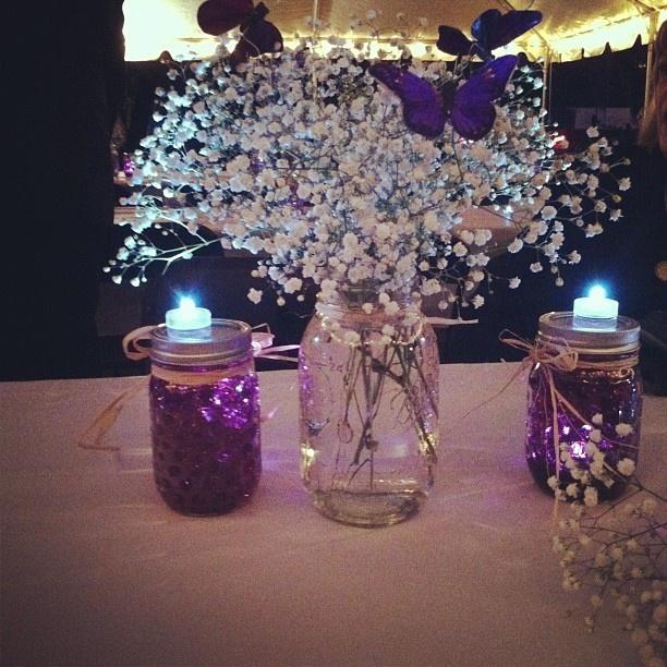 The centerpieces mason jars babys breath raffia