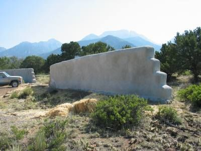 Complete strawbale 130 ft. wall, completed in 6 hours using straw bales, chicken wire, stucco and a stucco sprayer from mortarsprayer.com.