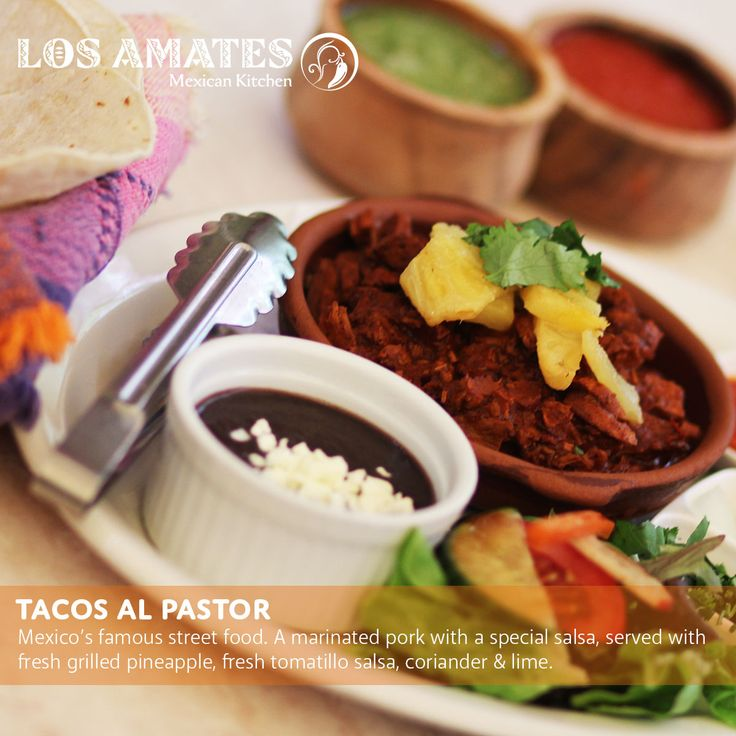 Tacos al Pastor  Mexico's famous street food. A marinated pork with a special salsa, served with fresh grilled pineapple, fresh tomatillo salsa, coriander & lime with corn tortillas de El Cielo