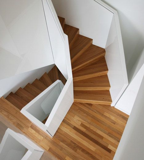 This faceted spiral staircase was created by Czech architects EDIT! to join two neighbouring apartments in Prague.
