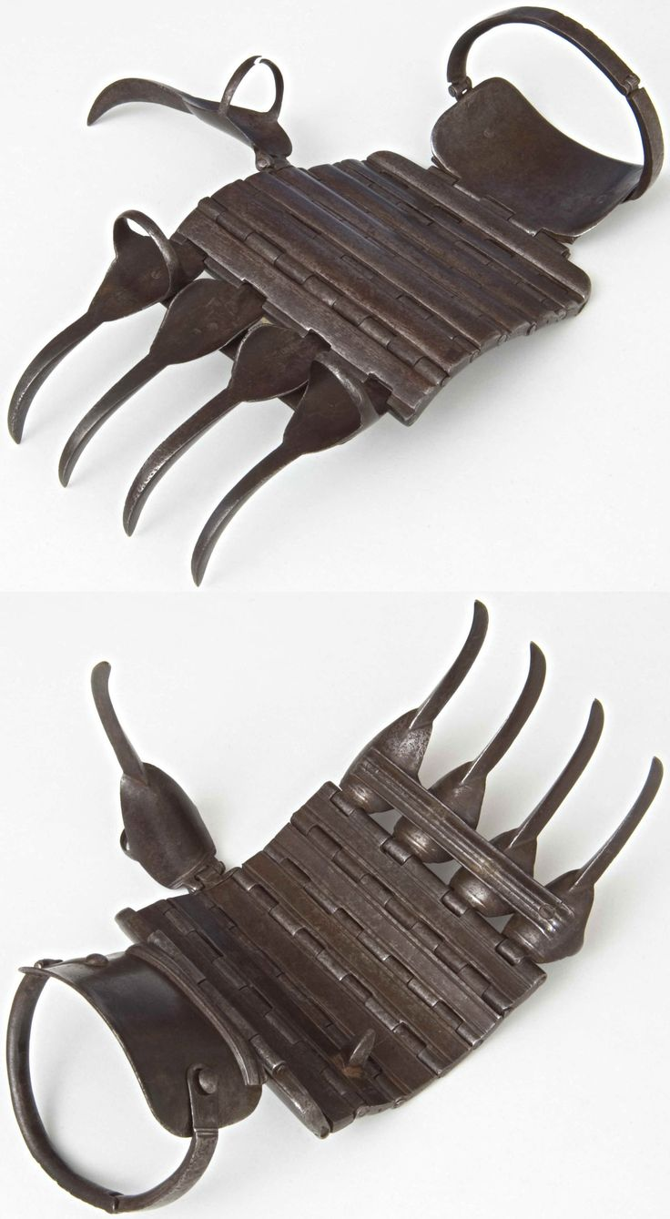 Indian (Maharashtra) bagh nakh (tiger claws), 18th to 19th century, the Feldman Collection. An unusual form of bagh nakh in the shape of an articulating steel glove.