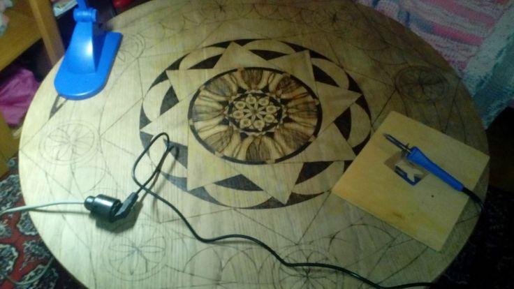 pyrography mandala on the table