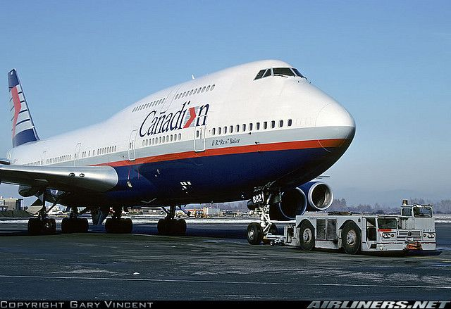 "Canadian Airlines Boeing 747-475 C-FCRA ""F. R. ""Russ"" Baker"" being towed to the gate at Vancouver-International, November 1991. (Photo: Gary Vincent)"