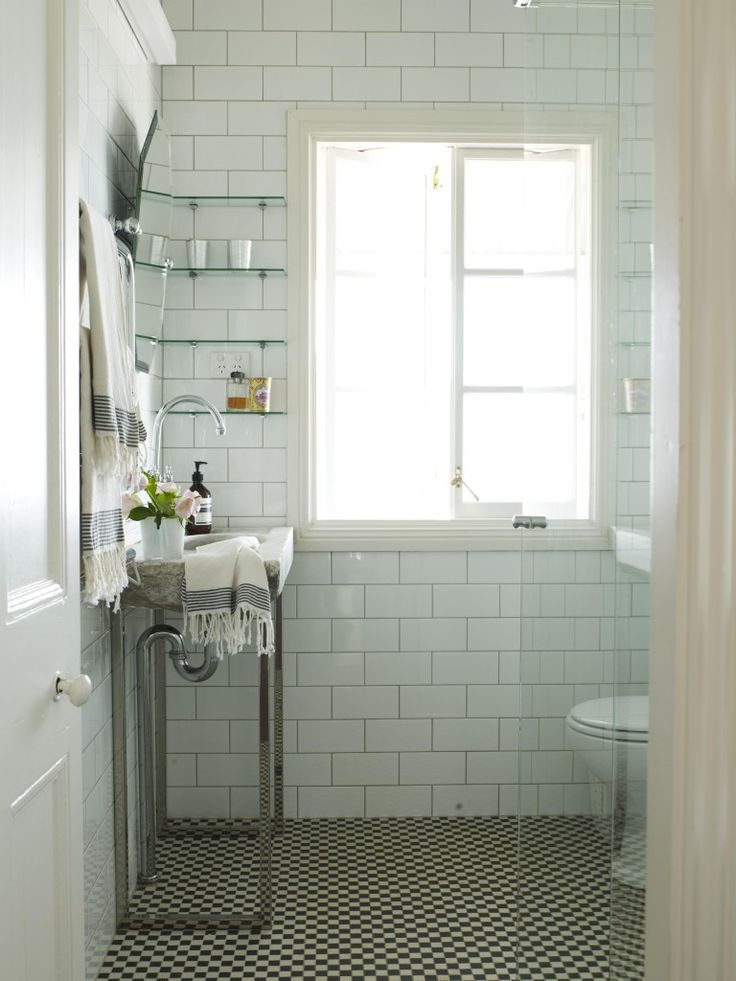 Metro tiles and white and metal bathroom. Simple, clean and timeless design.