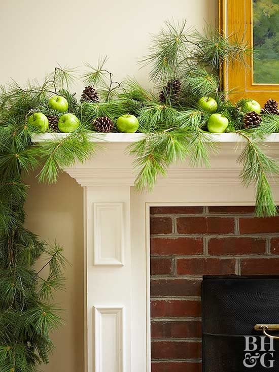 Pinecones on a fireplace mantle are a simple and elegant way to make your home feel warm and cozy. Start by draping a natural garland across the length of your mantle. Next, lay the pinecones on top of the garland, alternating setting them upright and on their sides. Finish by nestling fresh apples between the pinecones to create a stunning and whimsical display.