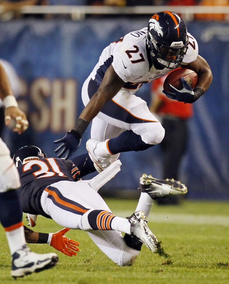 Denver Broncos running back Knowshon Moreno (27) eludes a tackle by Chicago Bears cornerback Isaiah Frey (31) during the first half of an NFL preseason football game in Chicago, Thursday, Aug. 9, 2012.