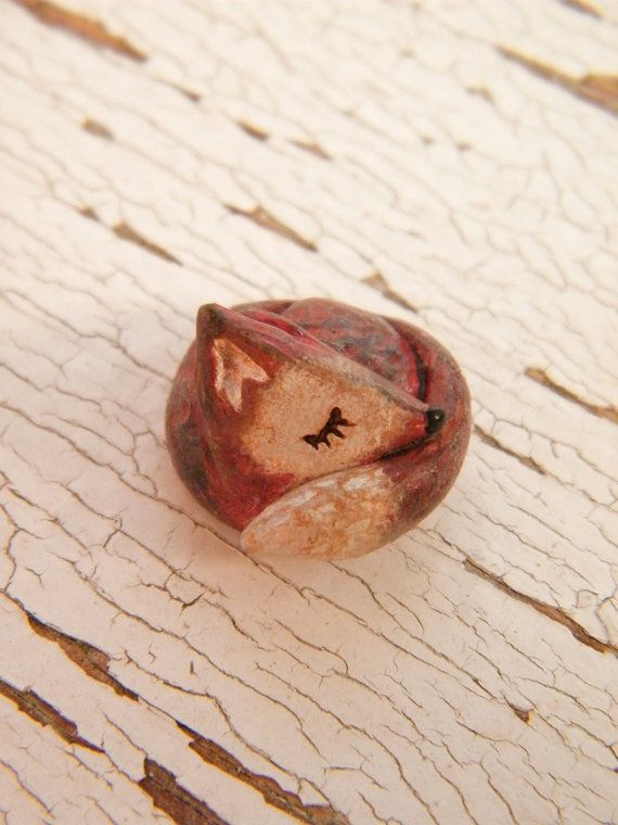 Pretty fox bead handmade out of polymer clay.