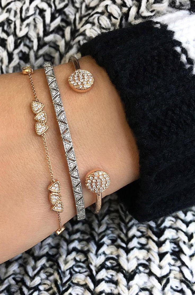 Arm full of stacked cuffs and cozy knits! #diamonds #bracelets #danarebecca