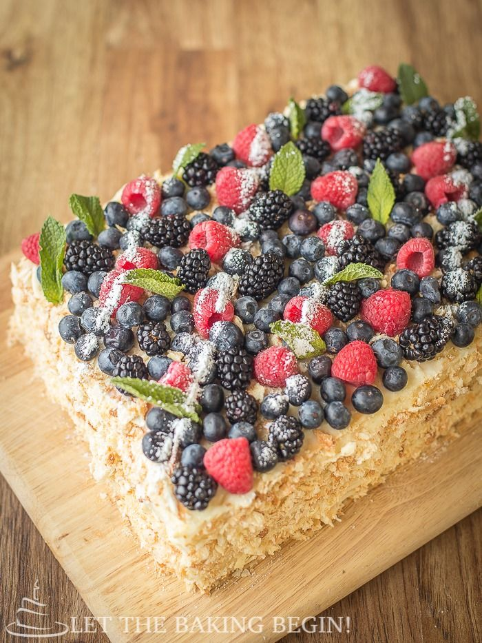 Delicious puff pastry cake, layered with custard & topped with berries. Plus a tip on how to speed up the baking process. by LetTheBakingBeg...