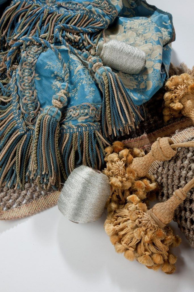 A collection of antique silk textile, antique silk tassels, gold and silver thread from Katharine Pole.