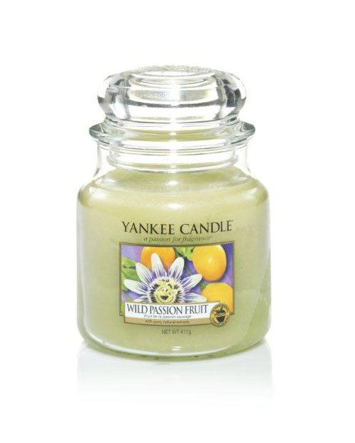 Wild Passion Fruit - Bright and vivacious ... this exotic passion fruit is blended with melon and mandarin. Romance walks on the wild side in the sun-drenched aroma of Wild Passion Fruit.  The traditional design of our signature jar candle reflects a warm, relaxed sense of style that is always at home. Convenient and easy to use, our medium Housewarmer Jar Candle provides 65 to 90 hours of true fragrance enjoyment.