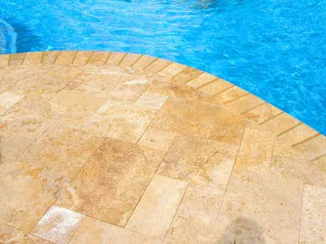 Travertine pool paver costs are less than you think. Find out what the prices are for a pool project compared to other paving materials such as pavers, concrete and bluestone.