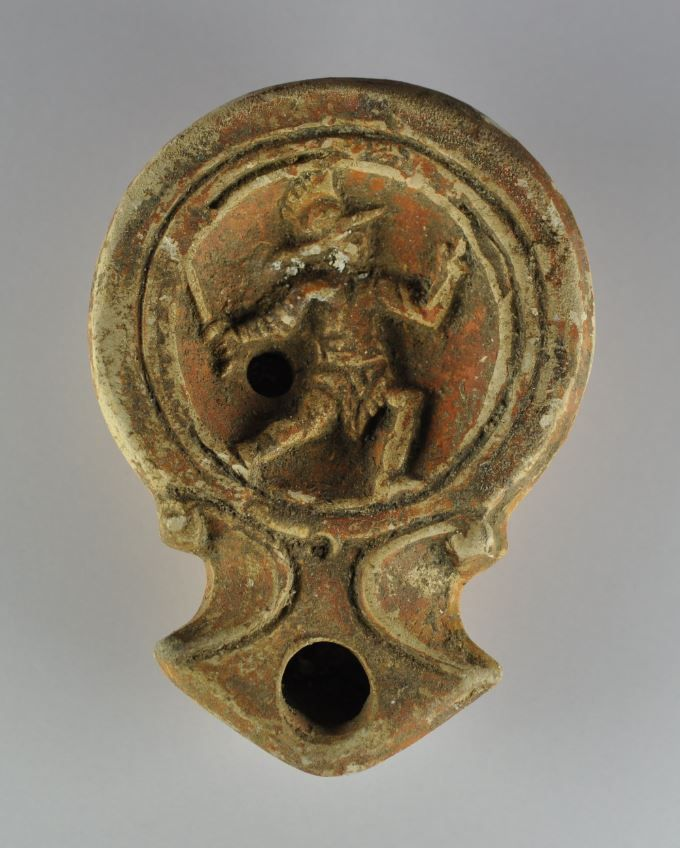 Roman oil lamp with gladiator, 1st-2nd century A.D. Roman oil lamp with gladiator represented probably during Colosseum gladiator fight, 8.5 cm long. Private collection