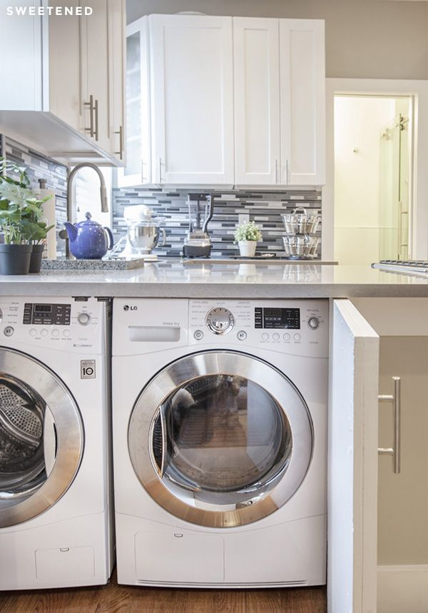 East Village kitchen features a laundry cabinet with an LG front-load washer and dryer pair!
