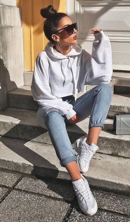 Hoodie sweatshirts, jeans, white sneakers, sunglasses, hoop earrings