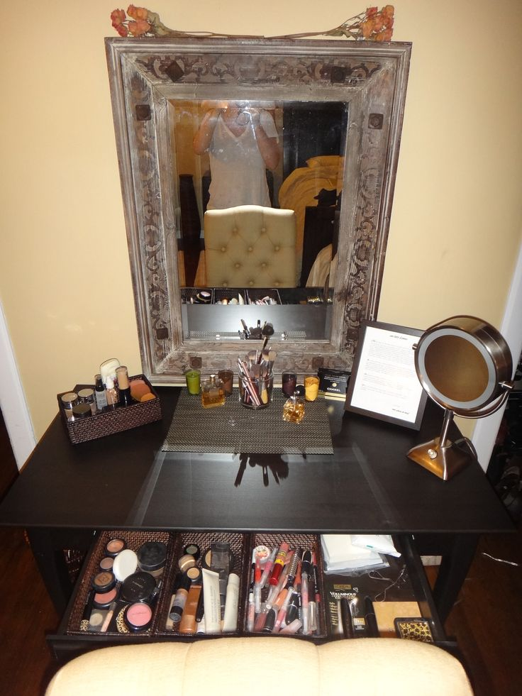 Writing desk from ikea converted into a vanity. Trays from Target