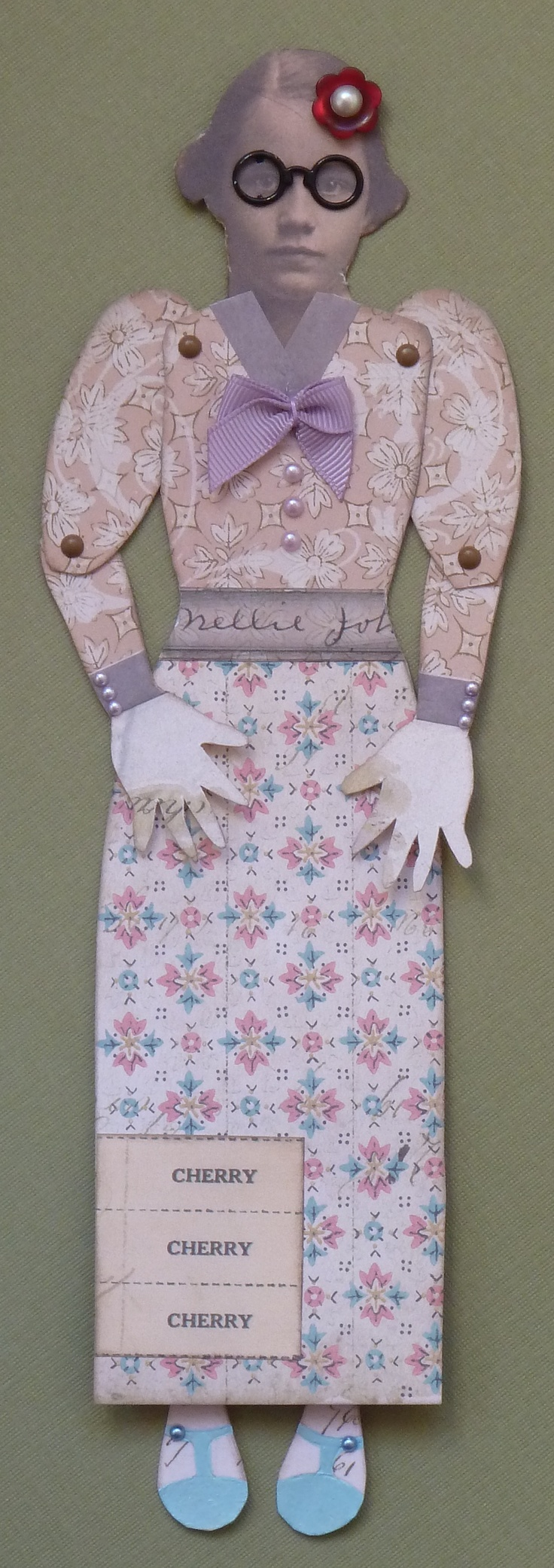 Nellie was made using The Artistic stamper art doll stamps and 7Gypsies Trousseau collection papers