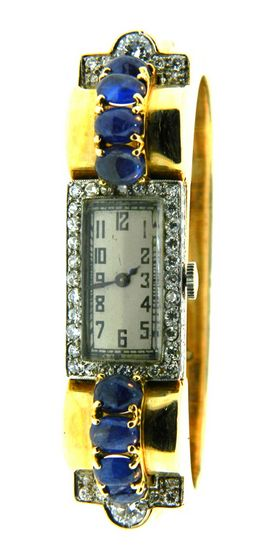 18kt Yellow Gold, Platinum, Sapphire and Diamond retro watch bracelet by Trabert & Hoeffer Mauboussin from the Reflection collection. circa 1940s.