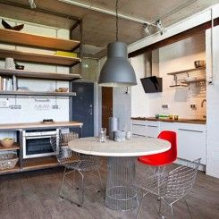 Apartamento de um quarto com decoração estilo industrial