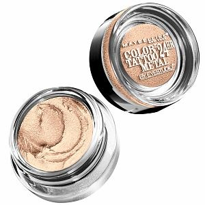 Apply Eye Studio Color Tattoo 24HR Cream-Gel Shadow in Barely Branded as a highlighter on the chin, cheekbones, bridge of the nose and the inner corners of the eyes.