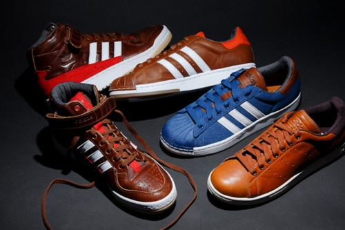 ADIDAS - Now These Are A Pair Id'e Keep As An Ornament For That Day I've Earned My 3 Stripes    Adidas Originals welcome a new Leather Pack to the brand's latest seasonal collection. Featured models include the almighty Superstar, timeless Stan Smith and classic Forum Mid. Each is decked out in a premium brown leather motif with blue and orange canvas paneling adding some additional flavor. Four different styles are offered in total, with all of them now available through select Adidas.