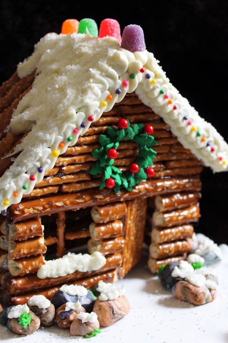 """Pretzel cabins- for that cute """"log cabin"""" look. What a great gingerbread house to make :)"""
